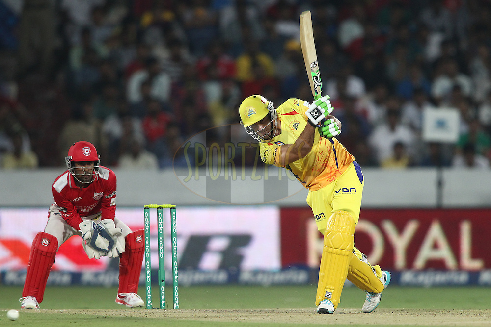 Francois Du Plessis of the Chennai Super Kings drives a delivery down the ground during the second semi final match of the Oppo Champions League Twenty20 between the Kings XI Punjab and the Chennai Superkings held at the Rajiv Gandhi Cricket Stadium, Hyderabad, India on the 2nd October 2014<br /> <br /> Photo by:  Shaun Roy / Sportzpics/ CLT20<br /> <br /> <br /> Image use is subject to the terms and conditions as laid out by the BCCI/ CLT20.  The terms and conditions can be downloaded here:<br /> <br /> http://sportzpics.photoshelter.com/gallery/CLT20-Image-Terms-and-Conditions-2014/G0000IfNJn535VPU/C0000QhhKadWcjYs