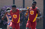 Mar 18, 2017; Los Angeles, CA, USA; T.J. Brock takes the handoff from Ricky Morgan Jr. on the anchor of the Southern California Trojans 4 x 100m relay that won in 39.31 during the Trojan Invitational at Cromwell Field.