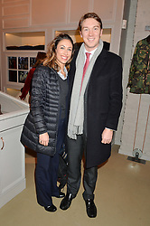 JONTY & ERIN SAUNDERS at the launch of the Private White VC flagship store, 73 Duke Street, London on 11th December 2014.