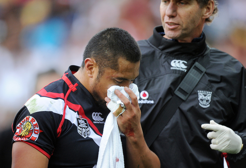 Warriors' Jerome Ropati leaves the field injured against the West Tigers in the NRL Rugby League match at Westpac Stadium, Wellington, New Zealand, Saturday, March 29, 2014. Credit:SNPA / Ross Setford