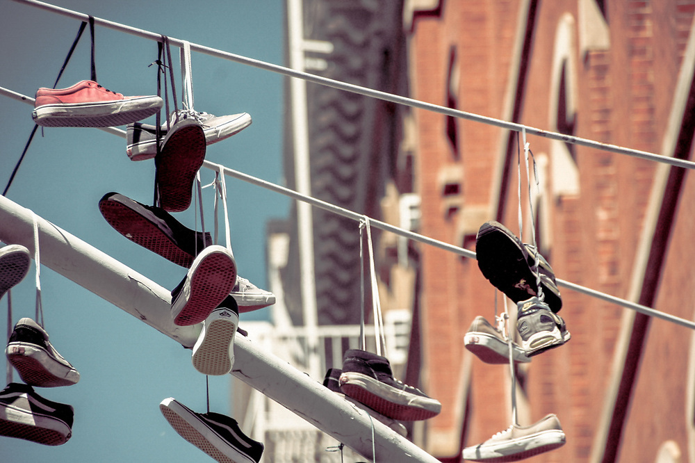 Many sneakers hanging from lines. NYC 2014