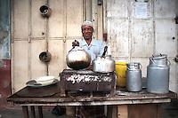 A street vendor sells chai, tea, and coffee in Mombasa, Kenya