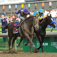 I'll Have Another, ridden by Mario  Gutierrez and trained by Doug O'Neill, wins the 138th Kentucky Derby at Churchill Downs in Louisville, Kentucky on May 5, 2012