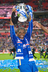LONDON, ENGLAND - Saturday, May 17, 2008: Portsmouth's match-winner Nwankwo Kanu celebrates with the trophy after his side beat Cardiff City 1-0 during the FA Cup Final at Wembley Stadium. (Photo by David Rawcliffe/Propaganda)