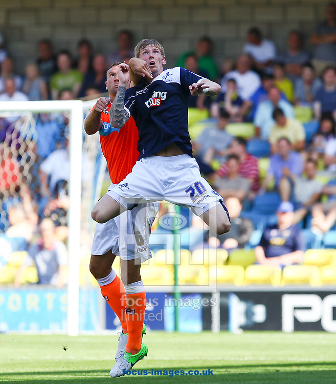 Picture by John  Rainford/Focus Images Ltd +44 7506 538356.18/08/2012.Andy Keogh of Millwall and Ian Evatt of Blackpool during the npower Championship match at The Den, London.