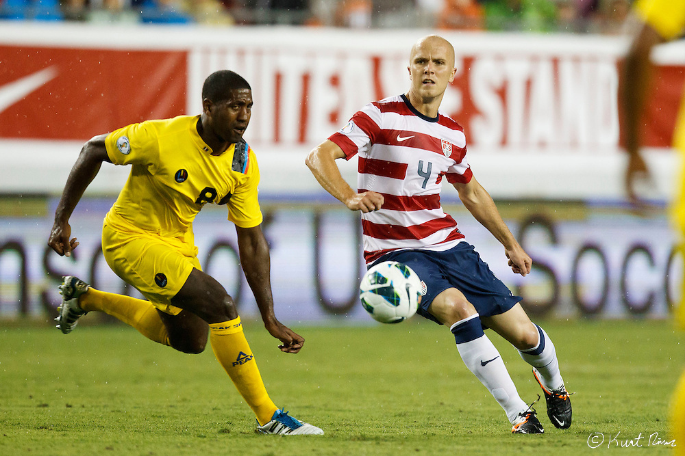 USA Men's National Team midfielder MICHAEL BRADLEY (4) and Antigua & Barbuda midfielder MIKELE LIGERTWOOD (8) go for the ball during the Antigua & Barbuda vs USA Men's National Team  semifinal round of 2014 FIFA World Cup qualifier at Raymond James Stadium in Tampa, Fl. .
