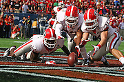 Jan 1, 2013; Orlando, FL, USA; Georgia Bulldogs wide receiver Justin Scott-Wesley (86), safety Marc Deas (23) and safety Connor Norman (11) attempt to recover a blocked punt against the Nebraska Cornhuskers during the first quarter of the 2013 Capital One Bowl at the Citrus Bowl.