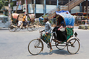 A cycle rickshaw carry passengers in Dhaka, Bangladesh.