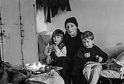 A woman with two young children at the Varazdin refugee camp in Croatia in the winter of 1992.