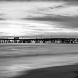 San Clemente pier black and white panorama photo. Panoramic photo ratio is 1:3. San Clemente is a popular coastal town in Southern California in the United States of America. Copyright ⓒ 2017 Paul Velgos with all rights reserved.