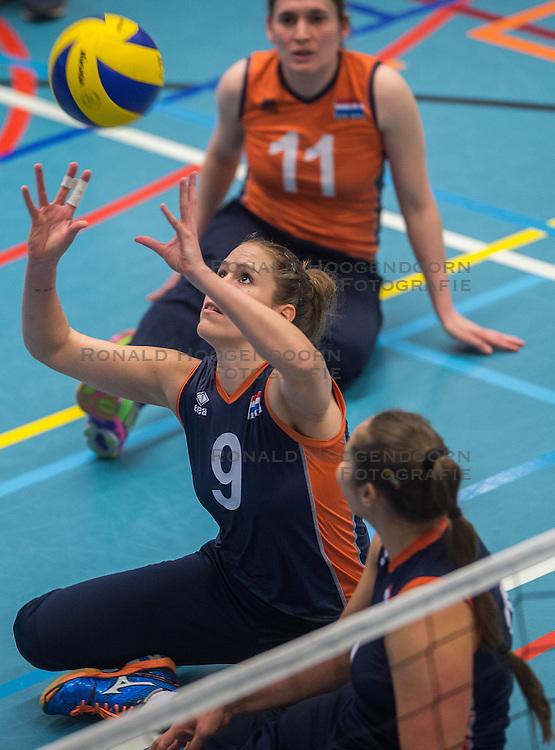 14-02-2016 NED: Nederland - Oekraine, Houten<br /> De Nederlandse paravolleybalsters speelde een vriendschappelijke wedstrijd tegen Europees kampioen Oekraïne. De equipe van bondscoach Pim Scherpenzeel bereidt zich tegen Oekraïne voor op het Paralympisch kwalificatietoernooi in China, dat in maart wordt gespeeld /  Annelies van de Bilt #9 of Nederland