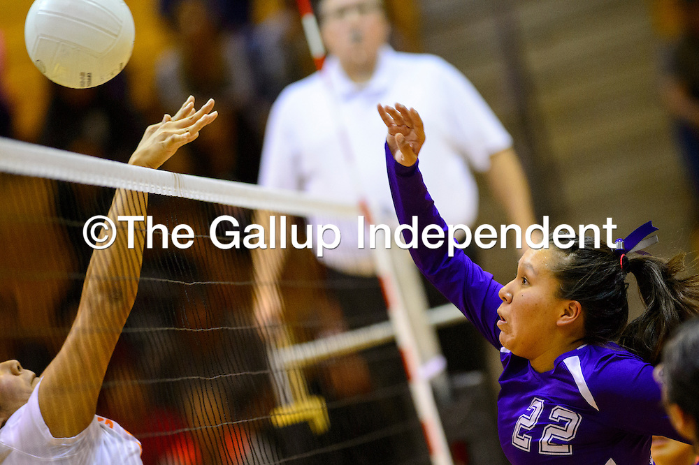 110314  Adron Gardner/Independent<br /> <br /> Miyamura Patriot Alaiah Nelson (22), right, spikes over a Gallup Bengal at Gallup High School Monday.