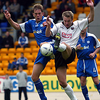 St Johnstone v Clyde..  05.10.02<br />Ian Maxwell and Alan Kernaghan challenge<br /><br />Pic by Graeme Hart<br />Copyright Perthshire Picture Agency<br />Tel: 01738 623350 / 07990 594431