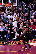Jun 6, 2018; Cleveland, OH, USA; Golden State Warriors forward Draymond Green (23) dunks the ball against Cleveland Cavaliers center Tristan Thompson (13) during the first quarter in game three of the 2018 NBA Finals at Quicken Loans Arena.