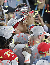 February 2, 2020, Miami Gardens, FL, USA: Kansas City Chiefs quarterback Patrick Mahomes kisses the Vince Lombardi Trophy in celebration after winning Super Bowl LIV, 31-20, against the San Francisco 49ers at Hard Rock Stadium in Miami Gardens, Fla., on Sunday, Feb. 2, 2020. (Credit Image: © TNS via ZUMA Wire)