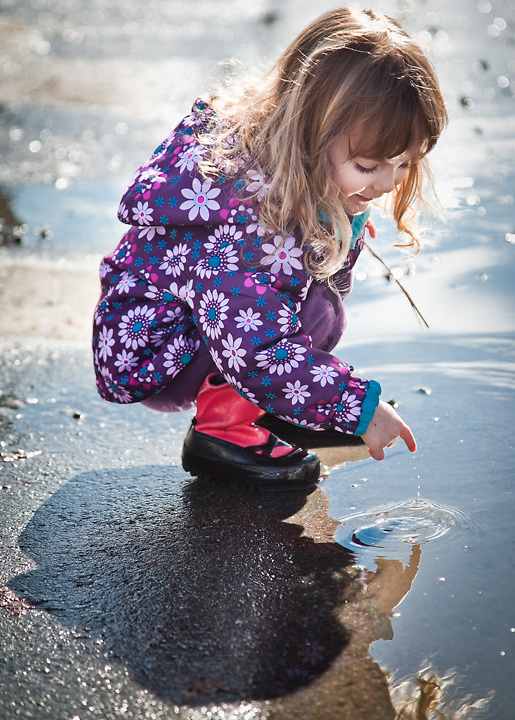 Adalyn Hatch, age 3, in her breakup boots during spring thaw, Anchorage, Alaska