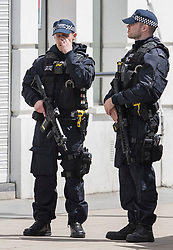 © Licensed to London News Pictures. 04/06/2017. London, UK. Armed police stand on Southwark Street after an attack by three men killed seven and injured at least 48. Police shot three attackers dead after they deliberately drove their van at people on London Bridge and then stabbed drinkers at bars in nearby Borough Market. Photo credit: Peter Macdiarmid/LNP