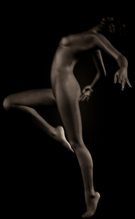 If you are an art photographer you totally understand the beauty of nude performing poses that serve as today's fine art.  This eloquent black and white photo shows the true beauty of the female form as she shares her sensuality, erotic side and her passion to become a true work of art.  This black and white photo is also romantic and pure as the adult dancer seems to be in deep thought through her moves.  Black and white nude photos such as this are attractive and sexy while having a sense of charm and romance.