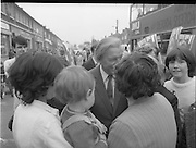 15/05/1982<br /> 05/15/1982<br /> 15 May 1982<br /> An Taoiseach, Mr Charles Haughey, canvasing with Fianna Fail bye-election candidate Eileen Lemass in Dublin West. Image shows An Taoiseach (centre) canvasing in front of the shops on Ballyfermot Road.