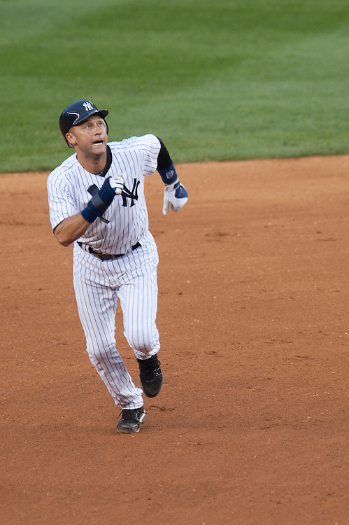 NEW YORK - AUGUST 13: Derek Jeter #2 of the New York Yankees runs the bases during the game against the Tampa Bay Rays at Yankee Stadium on August 13, 2011 in the Bronx borough of Manhattan. (Photo by Rob Tringali) *** Local Caption *** Derek Jeter