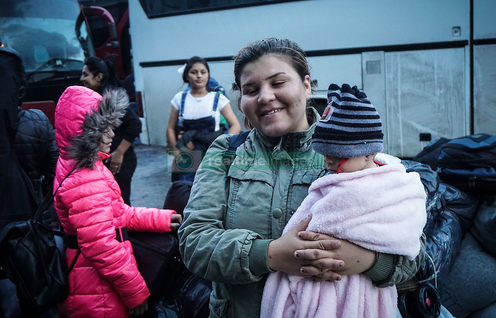 September 29, 2018 - Piraeus, Greece - A woman seen standing carrying a kid during their arrival at the port..400 migrants and refugees were transferred upon their arrival from the island of Lesbos, because the camp of Moria is full of refugees and migrants. (Credit Image: © Ioannis Alexopoulos/SOPA Images via ZUMA Wire)