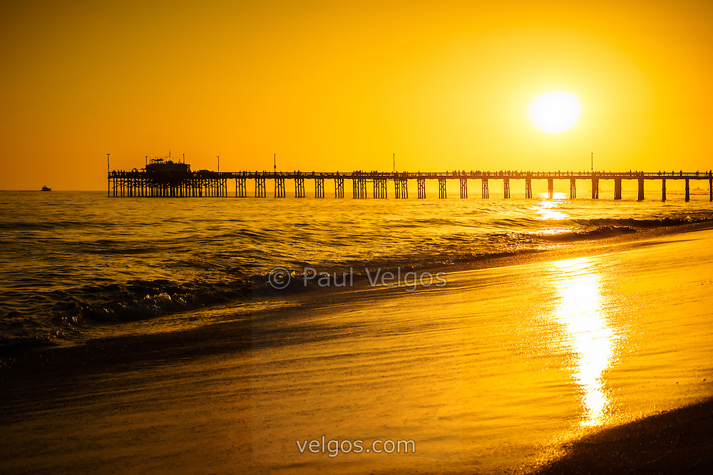 Balboa Pier sunset in Orange County California picture. Balboa Pier is located on the Pacific Ocean on Balboa Peninsula in Newport Beach California.