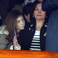 (PPAGE1)  WALL TWP  4/11/2003   Joan Curtin and daughter  watch as an American Flag is presented to the family    Michael J. Treola Staff Photographer.......mjt