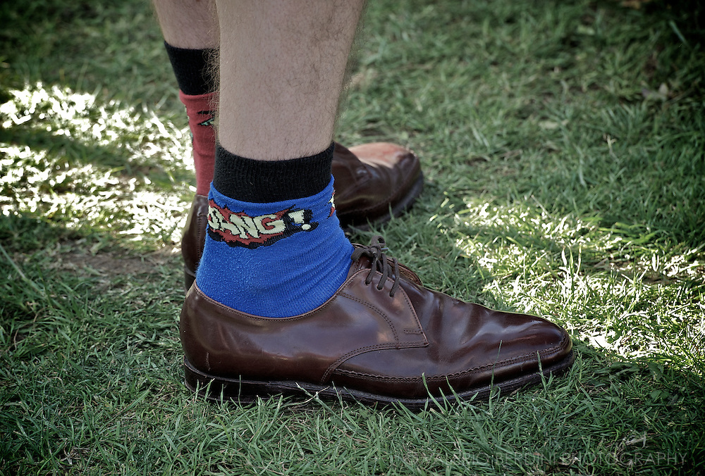 Short multicoloured socks, on shorts. With open-laced shoes.