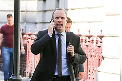 © Licensed to London News Pictures. 04/009/2019. London, UK. Foreign SecretaryDOMINIC RAAB speaking on the phone while walking to the House of Commons to attend British Prime Minister Boris Johnson's' first Prime Minister's Questions (PMQs). Photo credit: Dinendra Haria/LNP