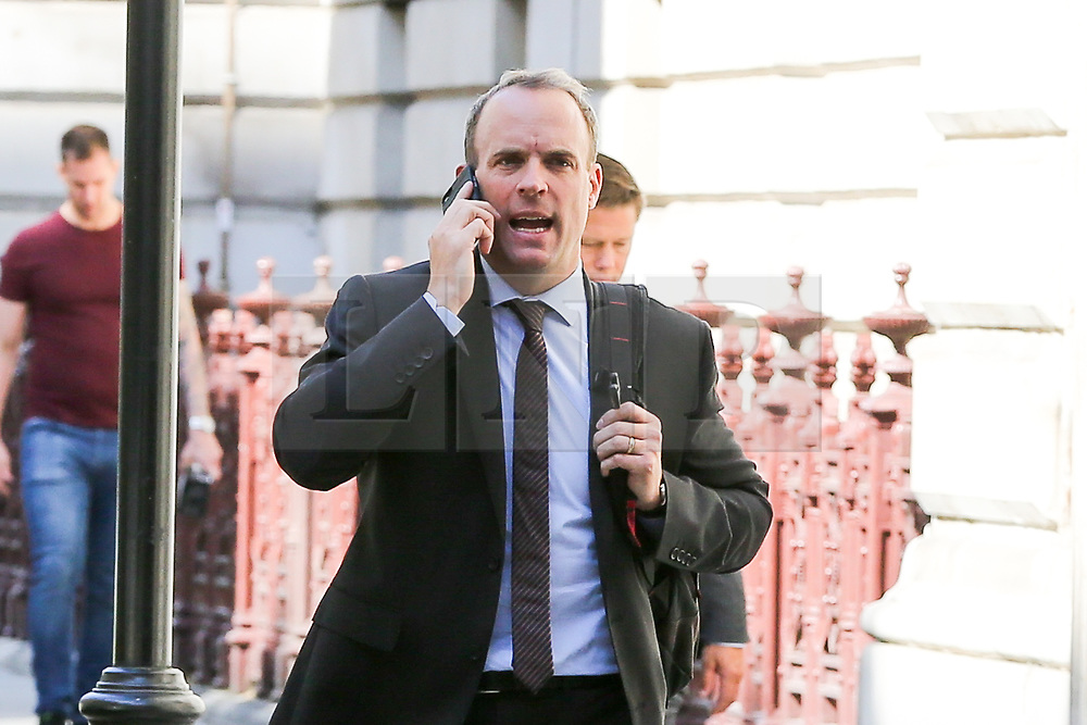 © Licensed to London News Pictures. 04/009/2019. London, UK. Foreign Secretary DOMINIC RAAB speaking on the phone while walking to the House of Commons to attend British Prime Minister Boris Johnson's' first Prime Minister's Questions (PMQs). Photo credit: Dinendra Haria/LNP