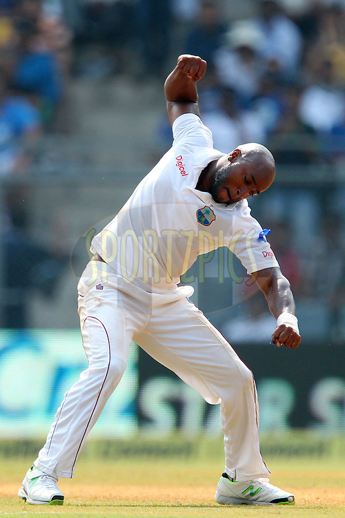 Tino Best of West Indies celebrates the wicket of Mahendra Singh Dhoni captain of India  during day two of the second Star Sports test match between India and The West Indies held at The Wankhede Stadium in Mumbai, India on the 15th November 2013<br /> <br /> This test match is the 200th test match for Sachin Tendulkar and his last for India.  After a career spanning more than 24yrs Sachin is retiring from cricket and this test match is his last appearance on the field of play.<br /> <br /> <br /> Photo by: Ron Gaunt - BCCI - SPORTZPICS<br /> <br /> Use of this image is subject to the terms and conditions as outlined by the BCCI. These terms can be found by following this link:<br /> <br /> http://sportzpics.photoshelter.com/gallery/BCCI-Image-Terms/G0000ahUVIIEBQ84/C0000whs75.ajndY