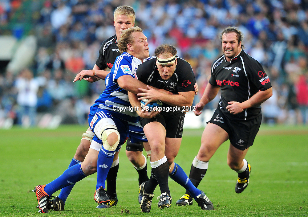 Kyle Cooper of the Sharks is tackled by Pat Cilliers of the Stormers during the Stormers 2013 Super Rugby game between the Stormers and the Sharks at Newlands Rugby Stadium on 13 April 2013 ©Ryan Wilkisky/BackpagePix
