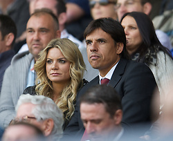SWANSEA, WALES - Saturday, September 22, 2012: Wales' manager Chris Coleman watches Swansea City take on Everton with Sky Sports presenter Charlotte Jackson during the Premiership match at the Liberty Stadium. (Pic by David Rawcliffe/Propaganda)