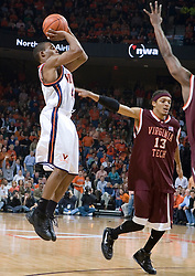 Virginia Cavaliers point guard Sean Singletary (44) shoots over Virginia Tech Hokies forward Deron Washington (13).  The Virginia Cavaliers Men's Basketball Team defeated the Virginia Tech Hokies 69-56 at the John Paul Jones Arena in Charlottesville, VA on March 1, 2007.