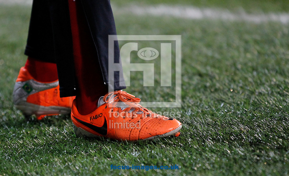 Fabio Da Silva's boots during the Barclays Premier League match at the Cardiff City Stadium, Cardiff<br /> Picture by Mike  Griffiths/Focus Images Ltd +44 7766 223933<br /> 11/02/2014