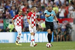 (L-R) Ivan Rakitic of Croatia, Ivan Perisic of Croatia, referee Nestor Pitana during the 2018 FIFA World Cup Russia Final match between France and Croatia at the Luzhniki Stadium on July 15, 2018 in Moscow, Russia
