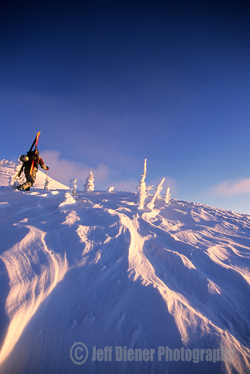 A backcountry skier hikes up Mt. Glory on Teton Pass, Jackson Hole, Wyoming.