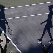 Shadows of Serena Williams, (left) and Venus WIlliams, USA, during their match against  Anastasia Pavlyuchenkova, Russia and Lucie Safarova, Czech Republic, in the Women's Doubles, Round 3 match at the US Open. Flushing. New York, USA. 4th September 2013. Photo Tim Clayton