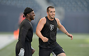 Aug 22, 2019; Winnipeg, Manitoba, CAN; Oakland Raiders wide receiver Antonio Brown (left) and quarterback Derek Carr before the game against the Green Bay Packers at Investors Group Field. The Raiders defeated the Packers 22-21.