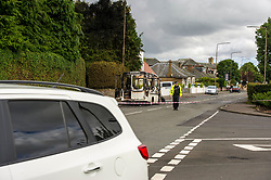 Pictured: Owners pick over what is left f their burnt out van on ehr junction of Bog Road and Carlops Road in Penicuik.  No injuries were reported in what appears to be a case of spontaneous combustion<br /> <br /> <br /> <br /> Ger Harley   EEm 26 August 2017