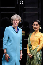 © Licensed to London News Pictures. 13/09/2016. London, UK. British prime minister THERESA MAY greets Myanmarese politician AANG SAN SUU KYI on the steps of 10 Downing Street ahead of a meeting between the two leaders.  Photo credit: Ben Cawthra/LNP
