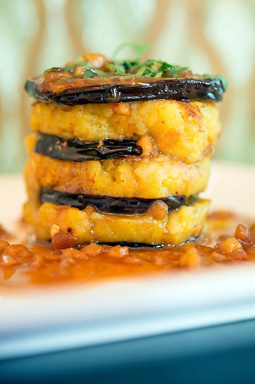 Photo by Matt Roth<br /> Assignment ID: 30142124A<br /> <br /> Tawa Baingan, made with eggplant, spiced potato, olive oil and peanut sauce. Rasika, one of Restauranteur Ashok Bajaj's most popular restaurants in Washington, D.C. on Thursday, May 09, 2013