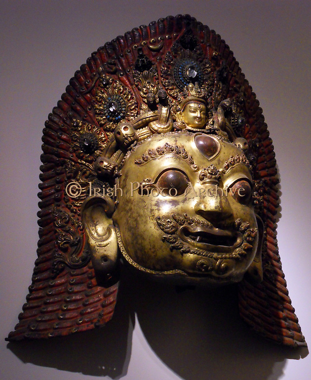 Mask of Bhairava. A destructive manifestation of Shiva. This Hindu deity was adopted by Tantric Buddhism of Tibet known as Vajrabhairava. 16th-17th century sculpture, copper encrusted, gilded and hammered