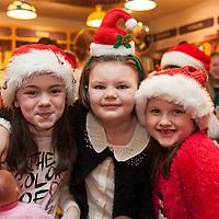 "Ailbhe Devitt, Ellie Coote and Robin Breen at the ""Santa Tales"" in Ennis Bookshop"