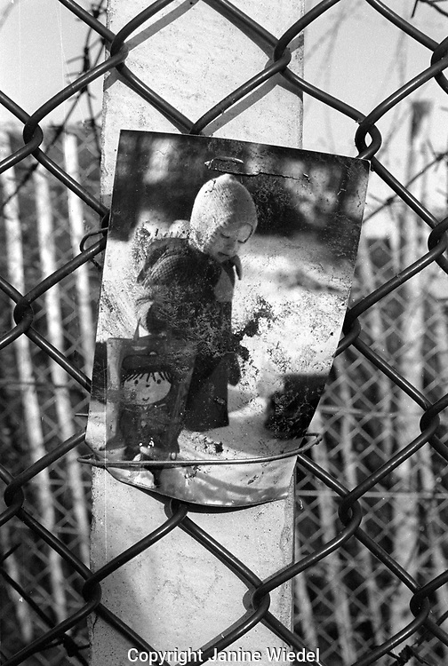 photographs of children pinned on the perimeter fence at the anti-nuclear Greenham Common Women's Peace Camp in 1983 / 1984. The women only camp surrounded the RAF  base in Berkshire (UK) where American cruise missiles were being stored.