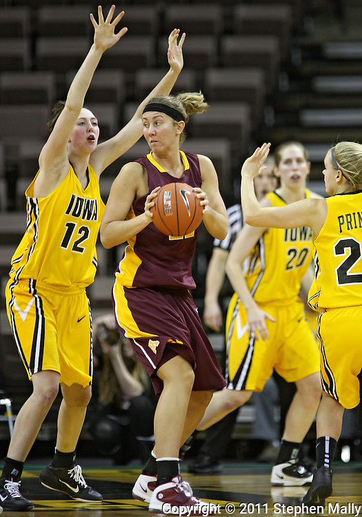 February 10 2011: Minnesota Golden Gophers forward Kristen Dockery (22) tries to get around Iowa Hawkeyes center Morgan Johnson (12) during the first half of an NCAA women's college basketball game at Carver-Hawkeye Arena in Iowa City, Iowa on February 10, 2011. Iowa defeated Minnesota 64-62.