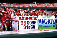 "ST. LOUIS, MO-SEPTEMBER 1998:   Fans gathered to watch Mark McGwire #25 of the St. Louis Cardinals take batting practice during what has been called the ""Great Home Run Race of 1998"" between McGwire and Sammy Sosa of the Chicago Cubs.  They were both attempting to break the single season home run record of 61 held by Roger Maris since 1961.  (Photo by Ron Vesely)"