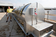 Tom Dittmer talks about one of their Biovator composters at Grandview Farms in Eldridge, Iowa on Thursday August 9, 2012.