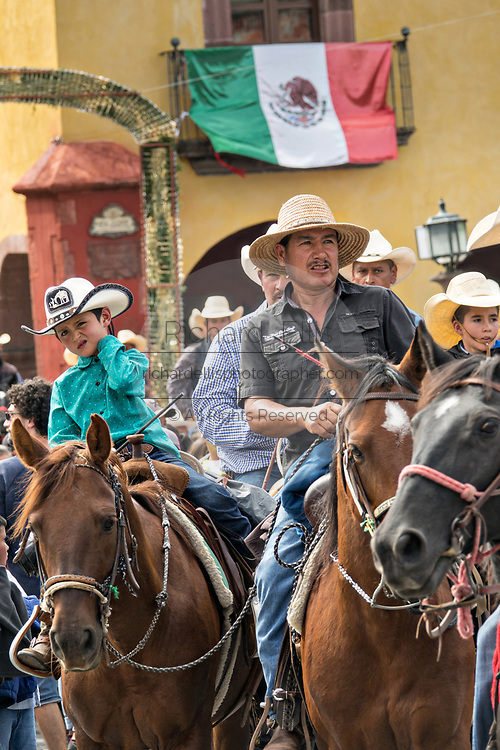 Mexican cowboys ride through the Jardin Allende at the end of their pilgrimage during the festival of Saint Michael in San Miguel de Allende, Mexico.