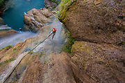 Rappelling 328 feet into the river Granados in Taxco, Guerrero. This river forms the waterfall named Thousand Waterfalls, Guerrero, Mexico.